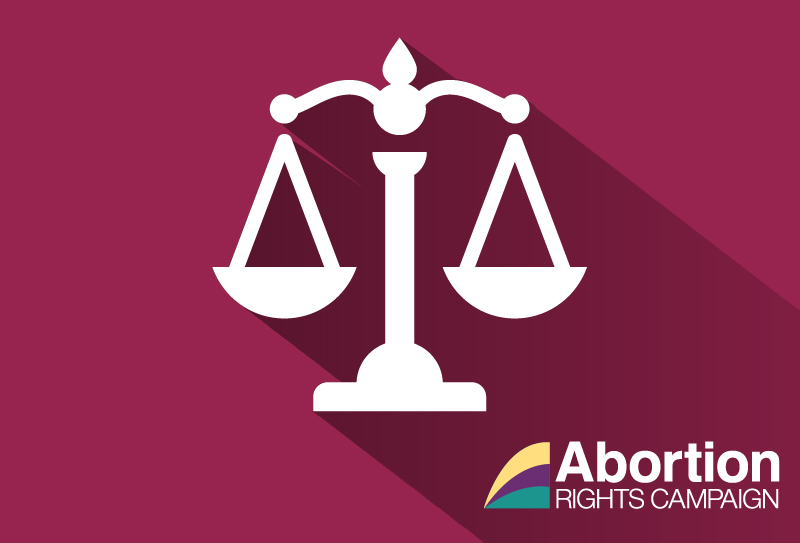 Image of white scales (of justice) on a maroon background, the ARC logo is in the bottom right corner