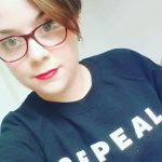 Photograph of Aideen O'Shaughnessy wearing a Repeal jumper