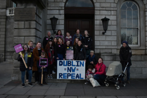 Members of Dublin North West Repeal pictured with placards