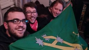 Rebels4Choice volunteers pictured on the couch of the title holding a green flag