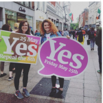 Therese Lynn Sarah Hourigan pictured on grafton street with Vote Yes placards