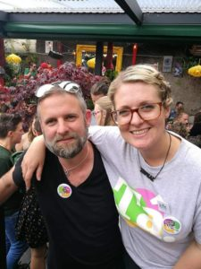 Photograph of a man and woman wearing Tá t-shirts at a repeal event